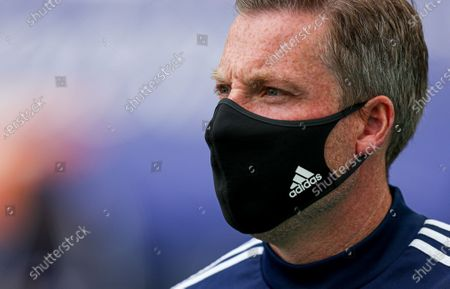 Cardiff City manager Neil Harris in a face mask before the start off the match
