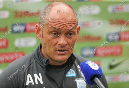 Alex Neil manager of Preston North End is interviewed before the start of the match
