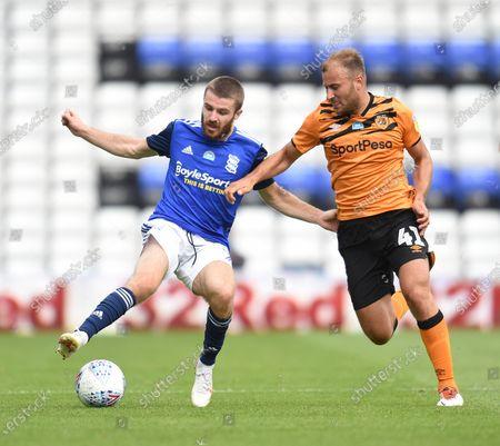 Dan Crowley of Birmingham City is challenged by Herbie Kane of Hull City.