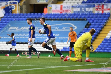 Gary Gardner of Birmingham City runs back up the field with the match ball after scoring the equalising goal.