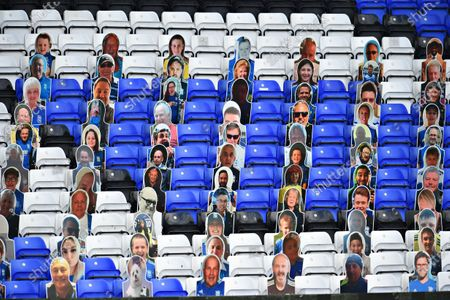 Cardboard cut outs of fans in the seats.