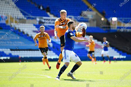Scott Hogan of Birmingham City  is challenged by Jordy de Wijs of Hull City.