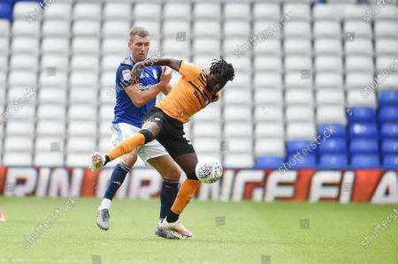 Gary Gardner of Birmingham City challenges Leonardo Lopes of Hull City.