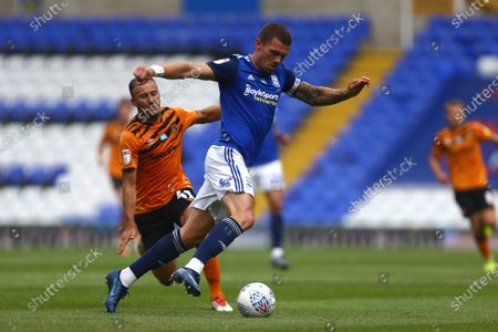 Harlee Dean of Birmingham City escapes Hull's Herbie Kane