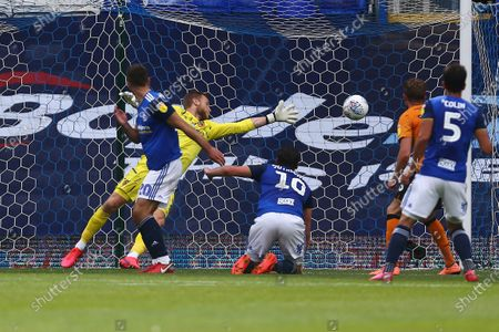 Gary Gardner of Birmingham City scores his sides third goal past Hull's George Long