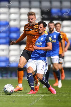 Hull's James Scott and Maxime Colin of Birmingham City