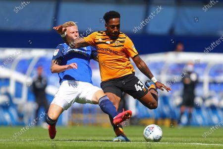 Kristian Pederson of Birmingham City tackles Hull's Mallik Wilks