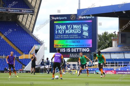 The big screen shows a message thanking the NHS and key workers for their effort during the Coronavirus / Covid-19 pandemic