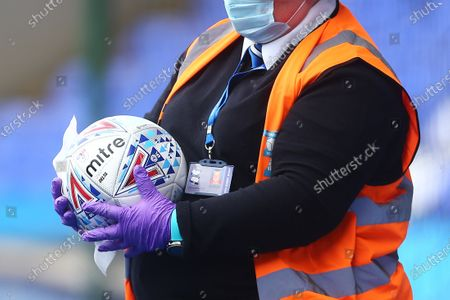 A member of staff wipes down the EFL Mitre Delta match ball