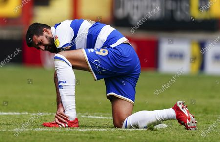 Yoann Barbet of QPR goes down with an injury late on