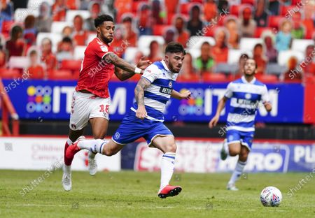 Ryan Manning of QPR battles with Andre Green of Charlton Athletic