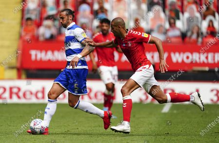 Geoff Cameron of QPR is chased by scorer Darren Pratley of Charlton Athletic