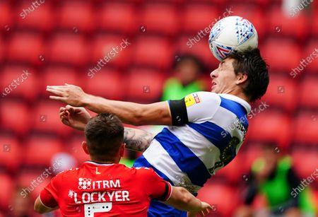 Jordan Hugill of QPR heads under pressure from Tom Lockyer of Charlton Athletic