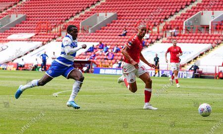 Bright Osayi-Samuel of QPR chases against Darren Pratley of Charlton Athletic