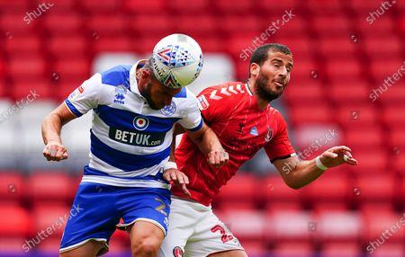 Angel Rangel of QPR heads against Tomer Hamed of Charlton Athletic