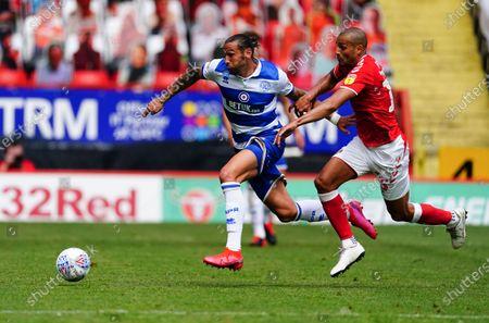 Geoff Cameron of QPR battles with scorer Darren Pratley of Charlton Athletic