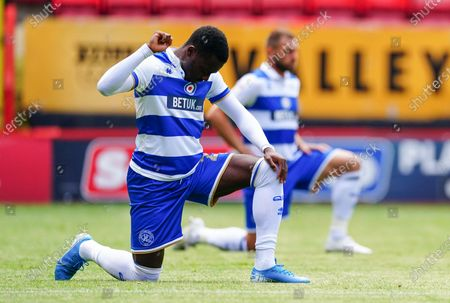 Bright Osayi-Samuel of QPR takes a knee