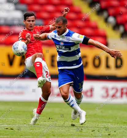 Stock Image of Josh Cullen of Charlton Athletic battles with Dominic Ball of QPR