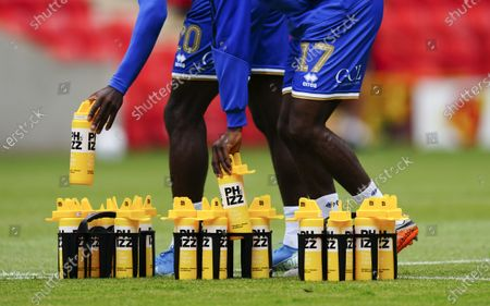 QPR players re-hydrate in the warm up