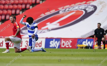 Eberechi Eze of QPR and Aidan McGeady of Charlton Athletic take a knee