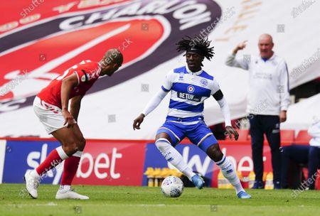 Eberechi Eze of QPR takes on Darren Pratley of Charlton Athletic