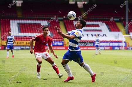 Ilias Chair of QPR juggles with the ball as Josh Cullen of Charlton Athletic looks on