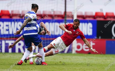Conor Masterson and Geoff Cameron of QPR combine to stop Tomer Hamed of Charlton Athletic