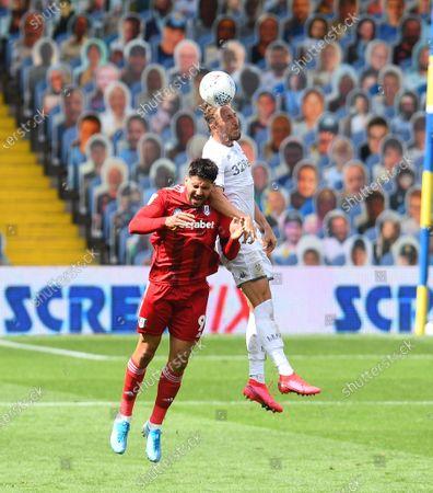 Aleksander Mitrovic of Fulham and Luke Ayling of Leeds United