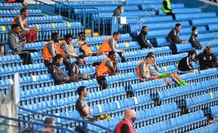 Fulham substitutes sit in the stands