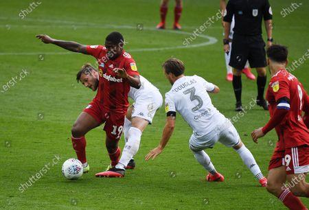 Ivan Cavaleiro of Fulham and Liam Cooper of Leeds United
