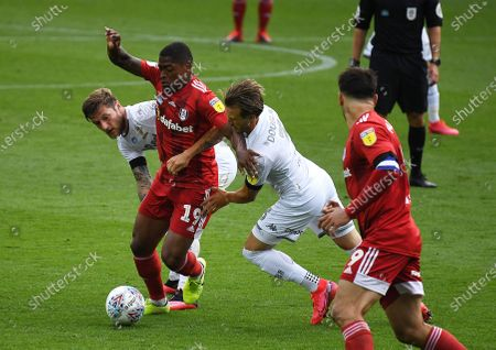 Ivan Cavaleiro of Fulham battles with Liam Cooper and Barry Douglas of Leeds United