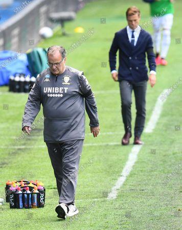 Marcelo Bielsa Manager of Leeds United followed by Fulham Manager Scott Parker
