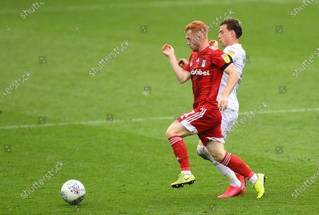 Harrison Reed of Fulham and Ezgjan Alioski of Leeds United