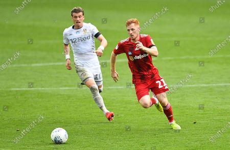 Ezgjan Alioski of Leeds United and Harrison Reed of Fulham