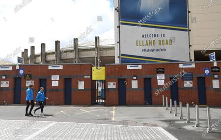 People walk past the closed turnstiles at Elland Road before kick off