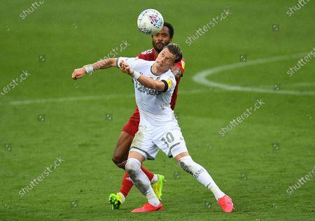 Ezgjan Alioski of Leeds United and Denis Odoi of Fulham