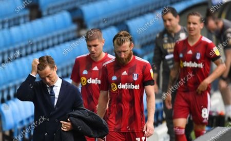 Fulham Manager Scott Parker and his players are dejected as they leave the pitch at full time