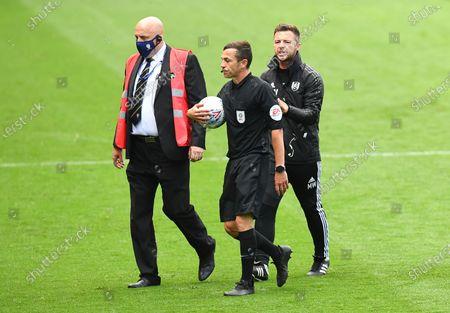 Matt Wells coach of Fulham speaks to referee Tony Harrington at half time