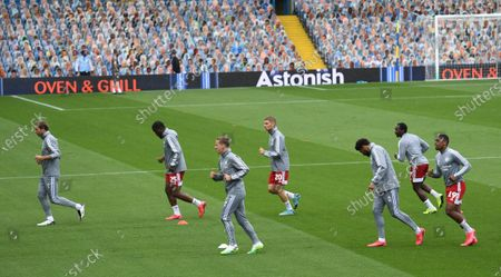 Fulham players warm up