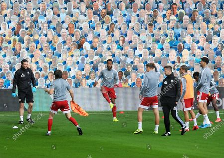 Fulham players warm up ahead of the game