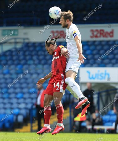 Bobby Reid of Fulham and Liam Cooper of Leeds United