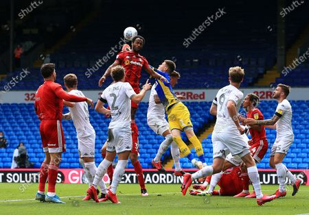 Denis Odoi of Fulham and Leeds United goalkeeper Illan Meslier