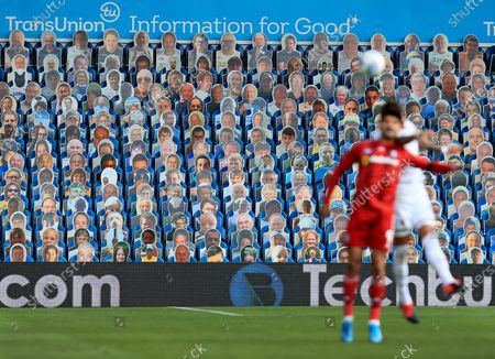Cardboard cut outs of Leeds United fans watch the game