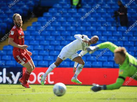 Tyler Roberts of Leeds United and Tim Ream of Fulham