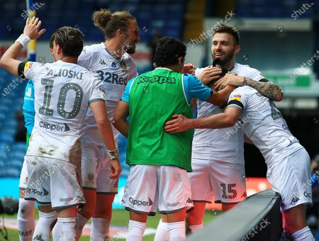 Jack Harrison of Leeds United celebrates scoring a goal to make it 3-0 with his team-mates