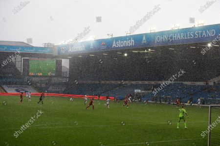 Heavy rain falls near the end of the game