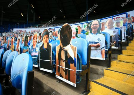 Cardboard cut outs of Leeds United fans including a family dog