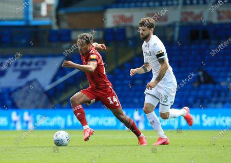 Bobby Reid of Fulham and Kalvin Phillips of Leeds United