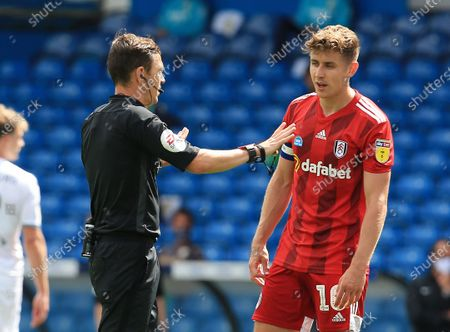Referee Mr Tony Harrington and Tom Cairney of Fulham