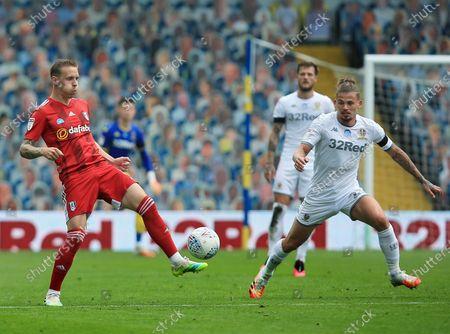 Stefan Johansen of Fulham and Kalvin Phillips of Leeds United